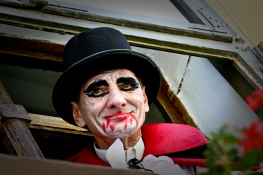 Dracula artist looking out of window Romania